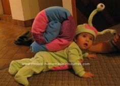 Homemade Baby Snail Costume: I wanted a belly costume for my daughter who wasn't yet walking. I made the snail shell out of strips of fabric sewn together and stuffed with batting.
