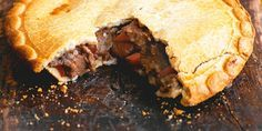 Steak And Ale Pie: Hearty steak and ale pie, made with Guinness, prime beef and topped with crisp pastry.
