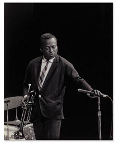 """Miles Davis - The thirty-four-year-old genius of ""progressive jazz"" trumpet is an individualist who favors skin-tight trousers, Italian-cut jackets. His seersucker coats, which have side vents, are custom made. His tailor: Emsley (New York), which charges $185 a suit."" - George Frazier, Esquire magazine, September 1960, from an article called 'The Art of Wearing Clothes' about the best-dressed men of 1960"