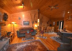 A great log home on Lake Bellaire, with water sparkles in the midst of northwest Michigan's beautiful countryside.