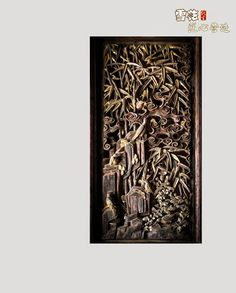 Traditional Chinese wood carving: birds in a bamboo grove