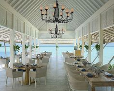 What a wonderful place to relax with some delicious food and drink! - The Maldives.