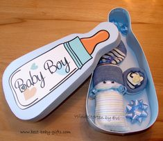 cute bottle shaped box for a baby money gift, I made a diaper baby to place in there and some decoration