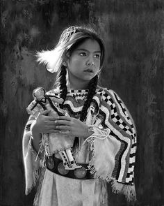 An excellent photograph of a young, beautiful Apache girl. The original is in color but I love the effect of black and white more.