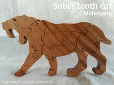 Hey, I found this really awesome Etsy listing at https://www.etsy.com/listing/196963385/saber-tooth-cat-stand-up-puzzle-in