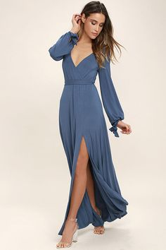 Lulus Exclusive! You'll never wonder what to wear to the party when you've got the Just the Thing Slate Blue Long Sleeve Maxi Dress! Jersey knit shapes a surplice bodice framed by long sleeves with cute, tying cuffs. An elasticized waist and tying sash tops a sweeping maxi skirt with a sexy thigh-high, side slit.