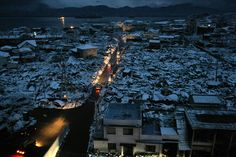Vehicle headlamps illuminated a disaster area in Yamada town in Iwate prefecture on March 16, 2011.  (Str/AFP/Getty Images) #