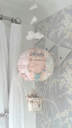 This DIY hot air balloon is made from recycled materials and is a precious addition to this upcycled nursery!