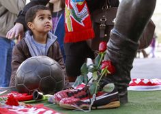A young boy looks at a statue of late Portuguese football player Eusebio da Silva Ferreira, also known as the 'Black Panther', outside the Luz stadium in Lisbon on January 5, 2014. Portuguese football legend Eusebio, who was the top scorer in the 1966 World Cup, has died today at the age of 71, his former club Benfica confirmed. The Mozambican-born Eusebio died of cardio-pulmonary arrest at 0430 GMT, the club said