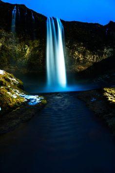 Seljalandsfoss at night - Seljalandsfoss waterfall at night. Vertical composition