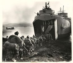 1950- Final day at the Hungham beachhead finds U.N. troops marching into an LST which will transport them to South Korea.