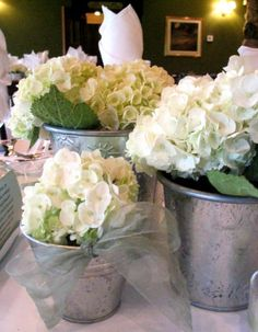 Love the shades of white with the tin and just of hint of green in the leaves…