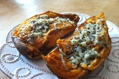 """Make boring baked potatoes awesome by twice-""""baking"""" them in the microwave. Mash up the insides with a fork, mix in cheese and anything else you like from the salad bar (scallions, bacon bits, etc.), and microwave for a minute to help everything meld. 