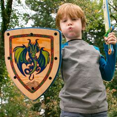 Handmade Wooden Toy Shield for pretend play with Dragon Design. Real non-toxic wood and soft EVA foam. Made in Portland, OR. Matching Wooden Sword available. #woodentoys #toys #madeinUSA