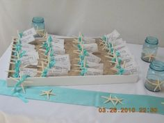 Love the starfish cards in sand. Can also be done with sand dollars... both sold in bulk at orientaltradingcompany