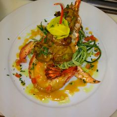Lobster with herbed breaded scallops, orange lobster and cucumber salad with lobster jus