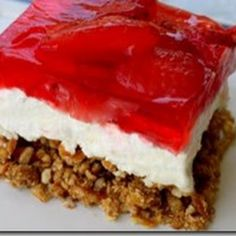 3 layers of deliciousness, starting with a bottom crust of sweetened crushed pretzels, a middle of creamy cream cheese  all topped off with strawberries in Jello. Recipe is easily adaptable to use your favorite fruit and Jello combo. Enjoy!