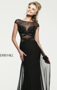 Dare to be gorgeous in Sherri Hill 21365. This exciting evening gown features a sheer bateau neckline with V-back design. The fitted bodice with slim waist defined by intricate beads creating a dazzling look.  A full length skirt will give you a dramatic finish.