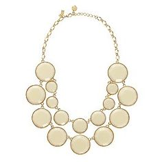 Baublebox Bib Necklace from Kate Spade New York. This is bold and dramatic in shape, yet simple. It says modern elegance to me. I bet the color would make it more versatile than you first expect.