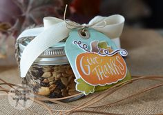 small mason jar filled with trail mix,  put circle die cut on top then wrap burlap ribbon & twill ribbon & tied off with a bow. For tag fold a tag then sponge with aqua ink on top & green on bottom then used Pumpkin Patch stamps & die cuts.