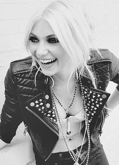 Taylor Momsen. Singer for The Pretty Reckless. I typically hate blondes and heavy make up, but this girl is stunning. As is her voice.