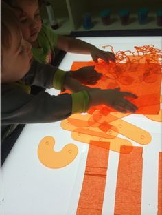Kids learn through hands-on and unstructured play on the light board Reggio Emilia, Learning Centers, Kids Learning, Missouri City, Light Board, Children Play, Light And Shadow, Light Table, Childcare