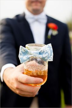 mason jar with bowtie http://www.weddingchicks.com/2013/08/30/southern-wedding-ideas/