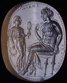 Dexamenos, active c.450 – 425 BC Engraved gem, c.430 BC   This tiny gem – 22 mm high, 17 mm wide and 8 mm deep – is one of only four surviving works signed by the engraver Dexamenos of Chios. His name is carved behind the legs of the stool on which the woman sits. Judging from the quality of his surviving work, Dexamenos was a major 5th century artist, albeit one who worked on a very small scale.  Another word is engraved at the top of the gem: Mikes, meaning 'of Mika,' the name,