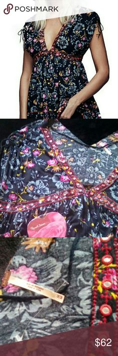 """Free People Escapades  shirt Free people BEAUTIFUL GORGEOUS SHIRT VIBRANT COLORS AND IT POPS OFF!! Material: 85% Lyocell 15%linen Made in INDIA Hand wash cold Do not wring or twist Lay flat to dry  Add this to your free people collection screaming WEAR ME Only been worn a few times Like new!! Lmk if you need better pics my husband took the last 2 and I will get more!! Measures 23"""" across laying flat under chest Arm opening 7"""" Length from shoulder17"""" to 26"""" as this is meant to be flowy Free…"""