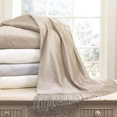 Charisma® Bamboo Throw - A layer of luxury for the bed, sofa or your favorite armchair, this generously sized throw from Charisma® is crafted of bamboo for a delectably soft and drapy hand.