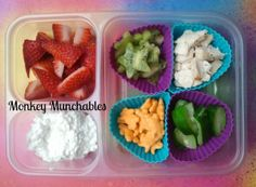 A yummy kid's lunch featuring lots of colorful food choices! Strawberries, Kiwi, Chicken, Zucchini, Annie's Organic Cheddar Bunnies, and Cottage Cheese. #monkeymunchables