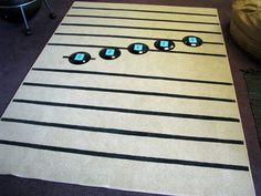 make a musical staff on a rug using tape for fun games during lessons