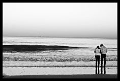 lovers at the edge of waters sea