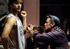 sexiness during his tattoo .. doesn`t he look great - even without doing his wind tunnel hair do !!
