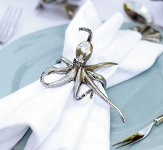 "Pewter Octopus Napkin Ring by Vagabond House This delightful pure pewter napkin ring is an intricately detailed replica of an octopus. Adds whimsy to your table setting. Dimensions: 3.5""""W x 2.25""""HPlease order in Quantities of 4."