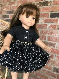 My test of Lorali by AllDolledUp.  Made with denim bodice with raw exposed edges, cotton polka dot skirt with netting overlay with larger polka dots, gripper snap front closure and a small dog collar used as belt (buckled in back)  fun dress, easy to make.
