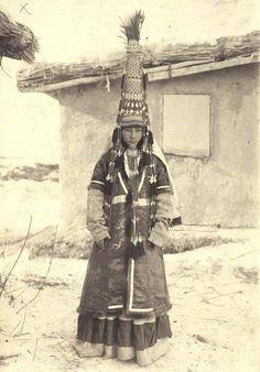 "Woman's wedding headdress ""Saukele"". Kazakh nomads, 19th cent, Kazakhstan, Central Asia. Wool and cotton cloth, metallic thread, fur of fox, copper, brass, silver, cornelian, corall, pearl. Total..."