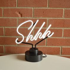 Let everyone know you're hard at work with the Shhh Desk Light from Fairgoods. The ultimately polite do not disturb sign is subtle and classy – just want you need in the office. Desk Light, Light Table, A Table, Open Space Office, Office Spaces, Neon Lamp, Library Displays, Christmas Gifts For Her, Book Nerd