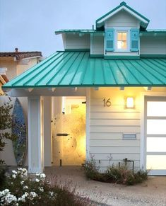 Turquoise roof shutters with anchors wave glass entry door and surfboard shower. Wow! Take the tour here:   Beach house | coastal home #beachhouse #coastalcottage #beachcottage