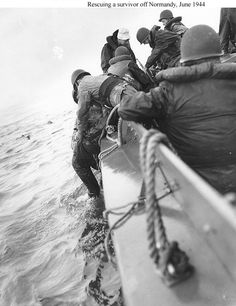A US Coast Guard boat pulls a survivor from the waters off Normandy