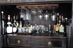 chinese cabinet turned bar by laura cattano. http://theorderobsessed.com/2011/01/03/chinese-cabinet-before-and-after/