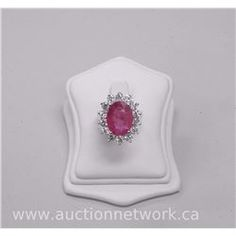 Ladies 18kt White Gold Diamond and Ruby Ring with 1 Oval cut Ruby (7.50ct) and 14 Round Brilliant Cu - Auction Network