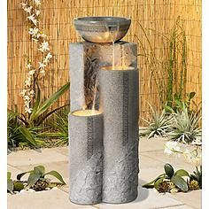 Maybe too 'formal'... but a vertical water feature might be a great choice. There are lots of options. This one is Faux Marble Bowl and Pillar Indoor Outdoor Fountain