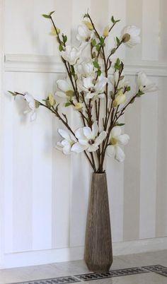 Magnolias in brown vase