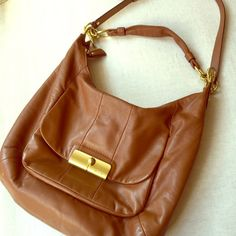 COACH Tan Leather hobo/cross body  bag Beautiful Tan leather Coach satchel with gold hardware and rosey pink lining. Removable cross body strap. Slight wear on the strap hardware (shown in last picture) but otherwise beautiful condition! Coach Bags Hobos