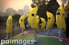 China Daily Life - People dressed in banana costumes stand outside a shopping mall as part of a promotional event on a polluted day in Beijing, Saturday, Oct. 17, 2015. China's capital is notorious for its air pollution, and air quality readings on Saturday were at hazardous levels by international measuring standards. (AP Photo/Mark Schiefelbein)