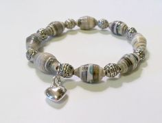 Hey, I found this really awesome Etsy listing at https://www.etsy.com/listing/202641495/grey-paper-bead-bracelet-first-1st-paper