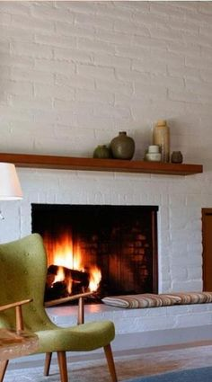 Painted brick fireplace with wood mantle