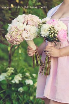 Bridal Bouquet: Pink hydrangeas, white peonies, and blush peonies with a lace wrap held with pearl pins. Bridesmaid bouquet: White peonies, pink peonies, and hypericum with a pink satin wrap. ~exactly what I want... now do I do it myself or not??