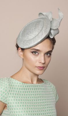 Gina Foster Millinery, Mint green pinok pok base with pinok pok stylised bow trim. A stylish hat perfect for a formal occasion or wedding. Secured with an elastic that sits under the hair. Worn on the right side of the head. The Andora can be made in alternative colours - please contact the Atelier for more information.